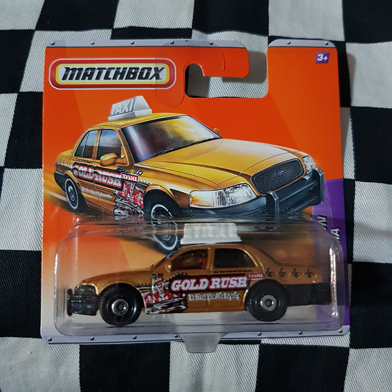 Matchbox 2010 Ford Crown Victoria Taxi Cab Gold