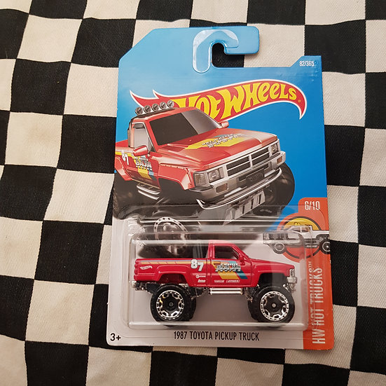 Hot Wheels 2015 Hot Trucks 1987 Toyota Hilux Pickup Truck RED
