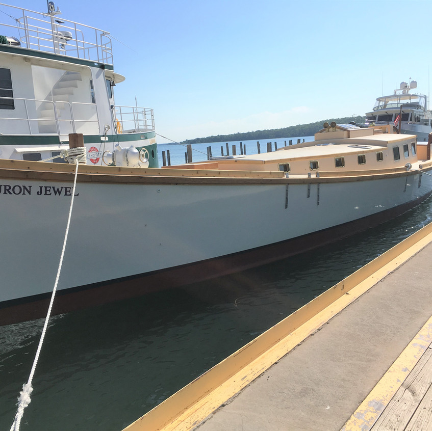 The new tall shop Huron Jewel stills a mast before she can set sail on the great lakes