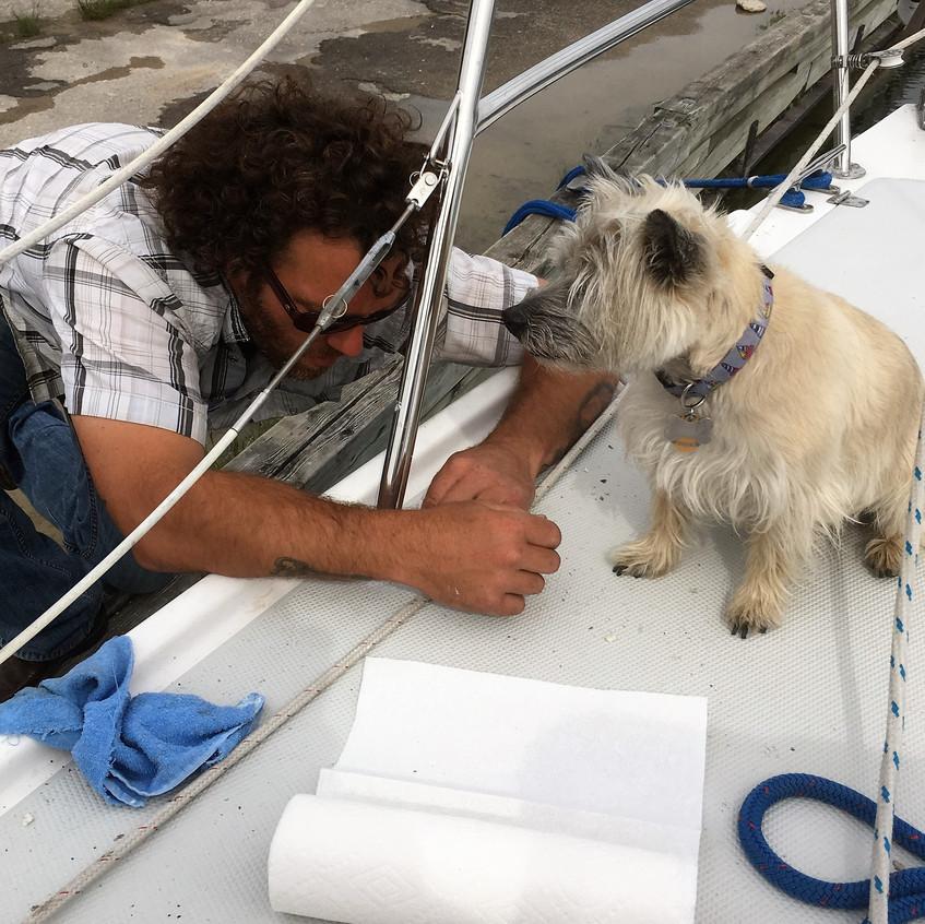 Duncan supervising boat repair