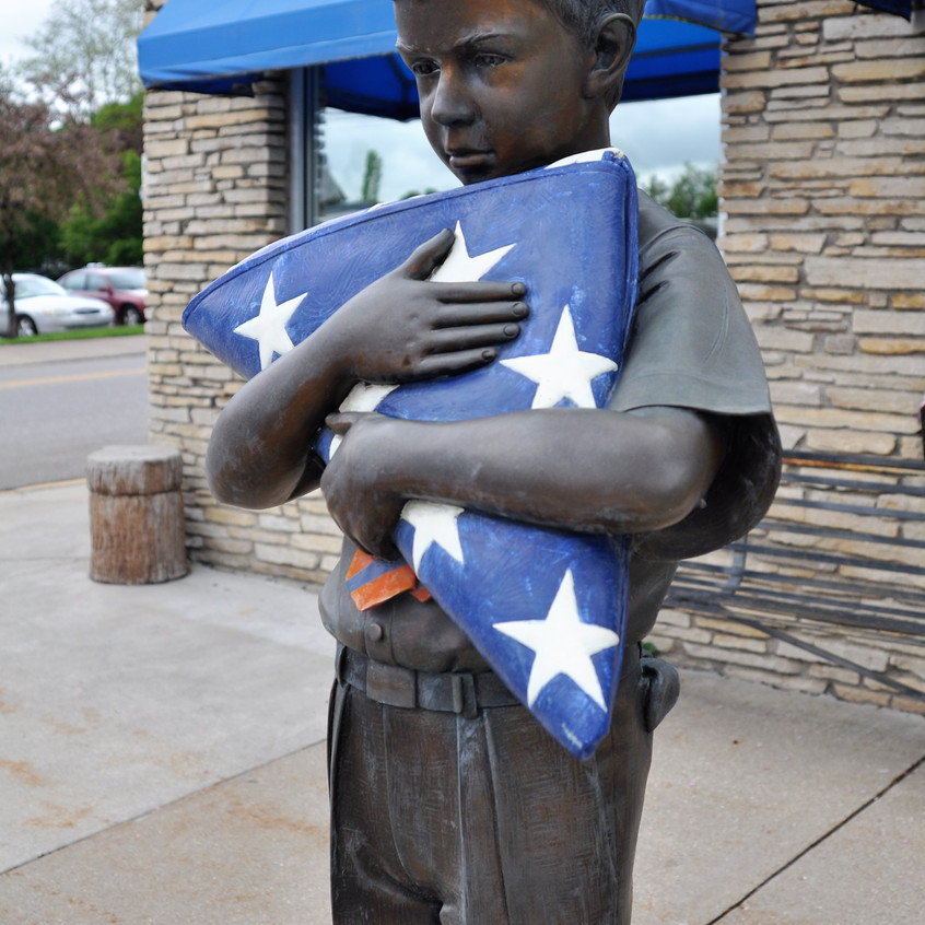 Boy with flag bronze 2