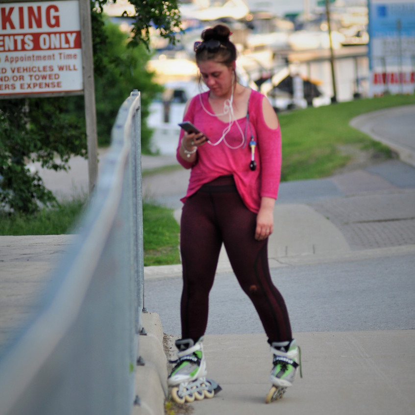 Inline skater looking at phone
