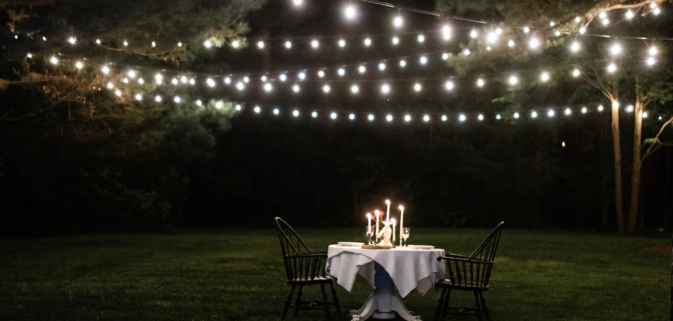 Open air candlelight table for two at Carriker Cottage