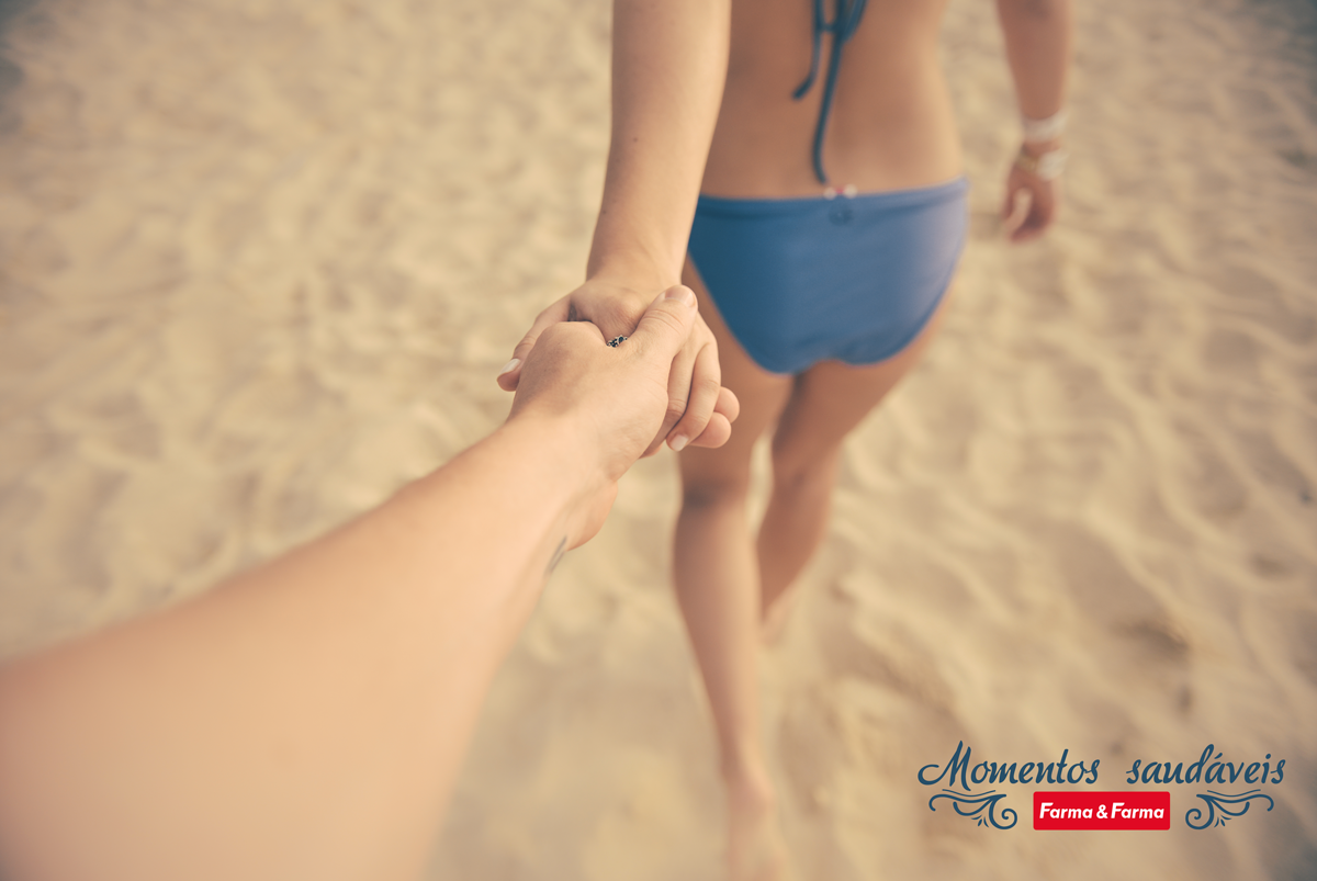 Lovers-Holding-Hands-On-Beach-With-Bikini