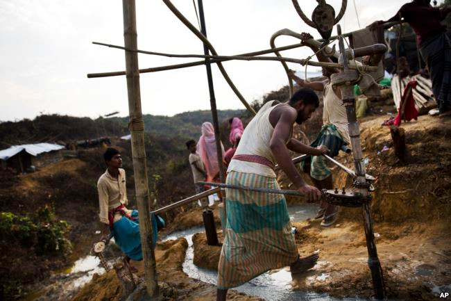 Bangladeshi laborers build a tube-well in a Rohingya refugee camp, in Cox's Bazar, Bangladesh, Oct. 29 2017.
