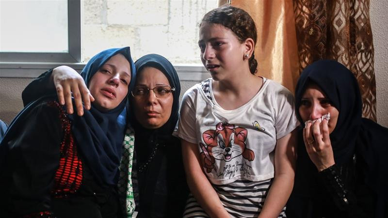 The mother of Amir al-Nimra, 15, second from left, and her three daughters at his funeral wake in Gaza