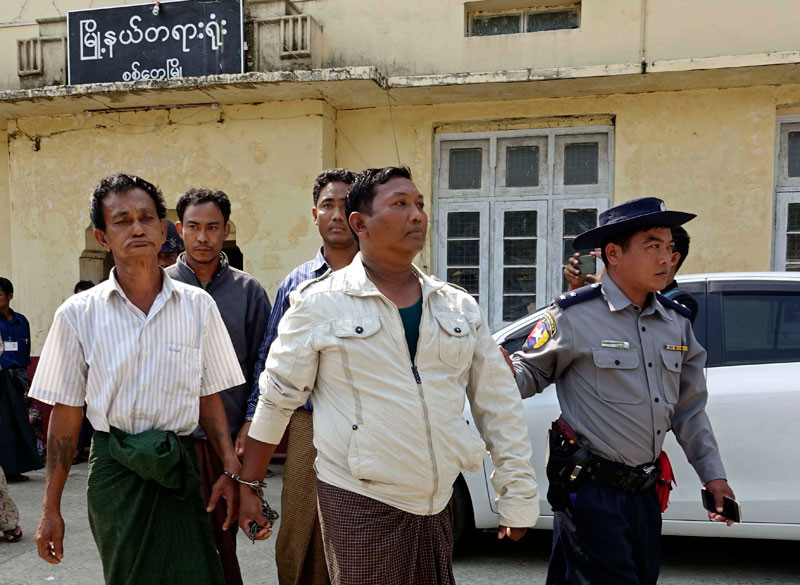 Bombing suspects Shwe Htet Aung (L, front), Than Shwe (R, front), Maung Oo Myint (L, back) and Naing Soe (R, back) are escorted out of court by a police officer in Sittwe, Rakhine State, Myanmar, 26 February 2018
