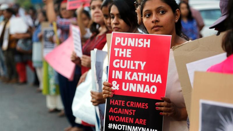 An Indian girl hold placard during a protest against two recently reported rape cases, in Ahmadabad, India on April 16, 2018