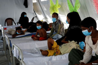 Rohingya refugees, who suffer from diphtheria, are treated at a Medecins Sans Frontieres (MSF) clinic near Cox's Bazar, Bangladesh, Dec. 18, 2017.
