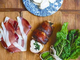 Stuffed chicken breast wrapped in prosciutto
