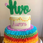 Custom two tiered fiesta cake with a custom topper
