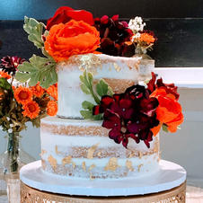 Fall Wedding Cake with naked icing and gold leaf accents