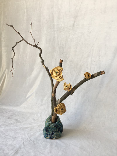 Fragile branch with roses