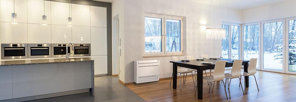 Modern open plan living home with floor mounted heat pump