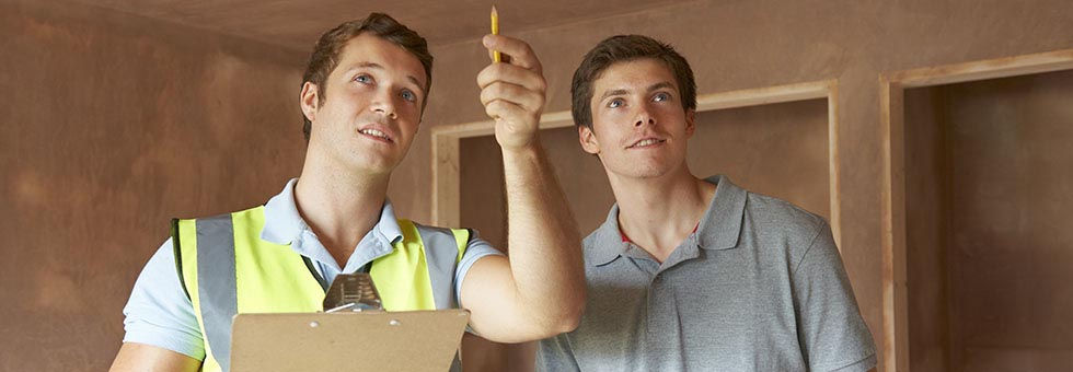 Electrician and electrical inspector discussing a project