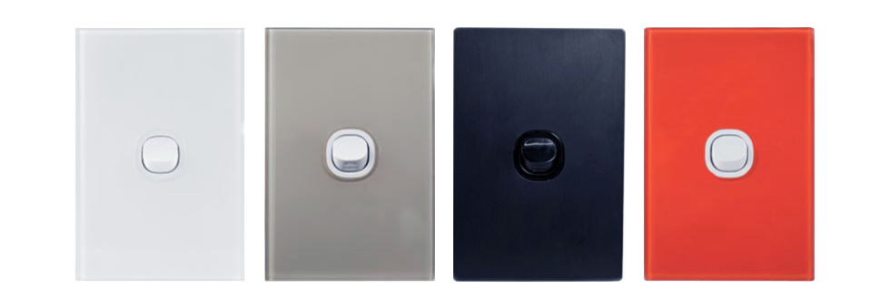 Four different coloured electrical light switch surrounds