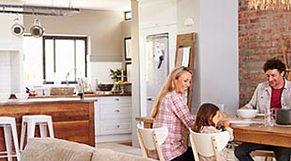 Family having breakfast in a modern open plan dining room
