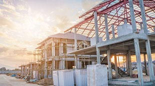 Commercial building site wth framework up at sunrise