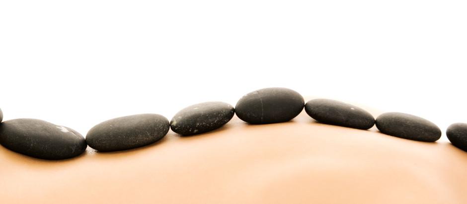 Beneficios del Masaje con Piedras Calientes