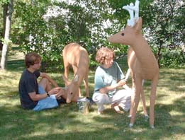 Children painting the deer