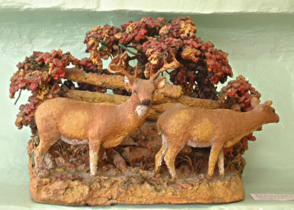 Small sculpture, Two deer by gate