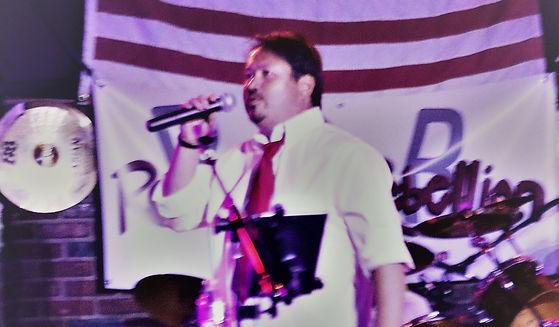 charles singing 2 cropped.jpg