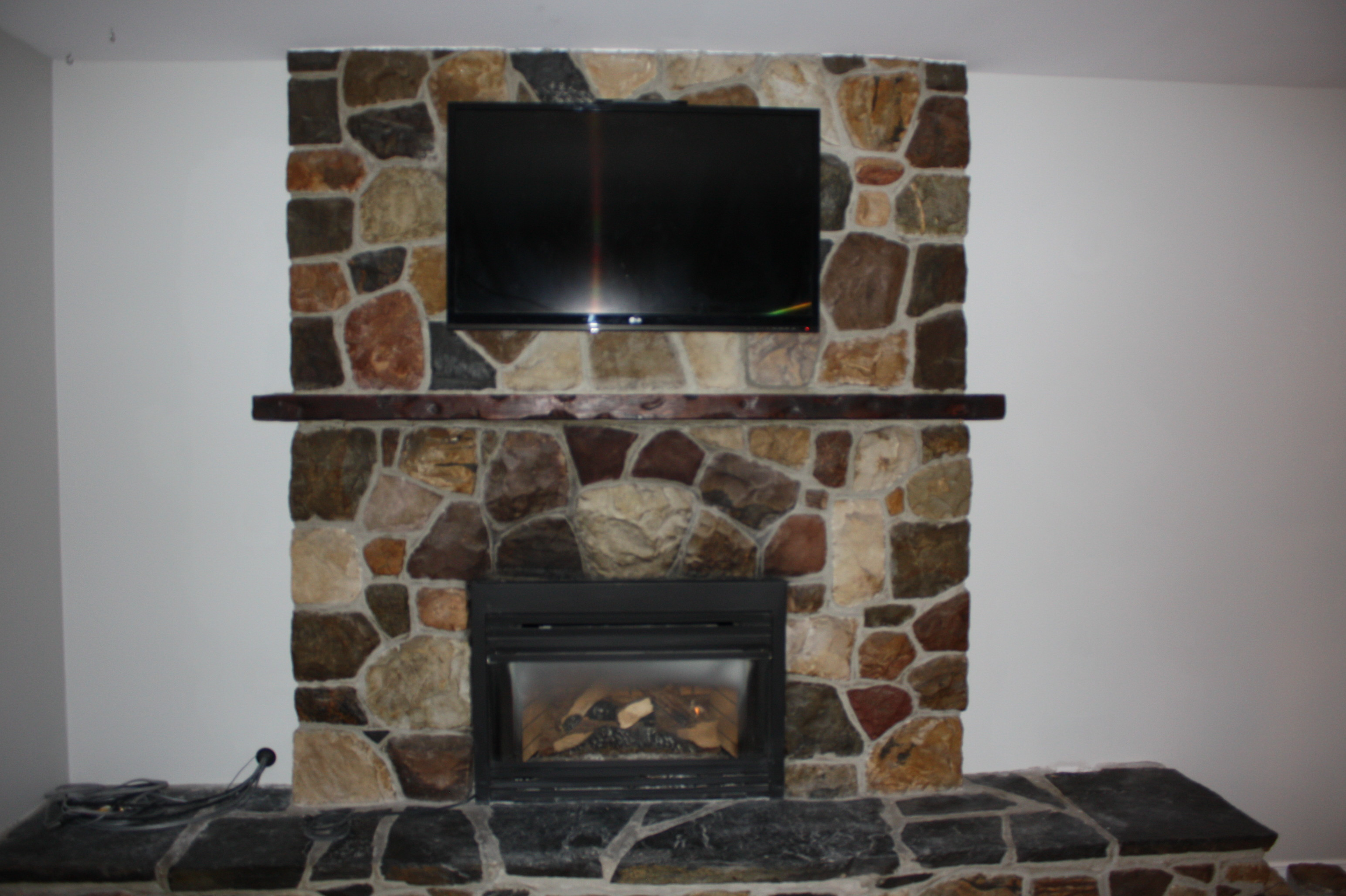 42_ Flat Panel Over Fireplace