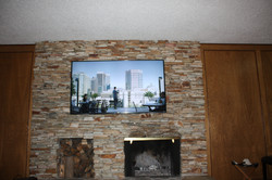 65_ Flat Panel Over Stone Fireplace