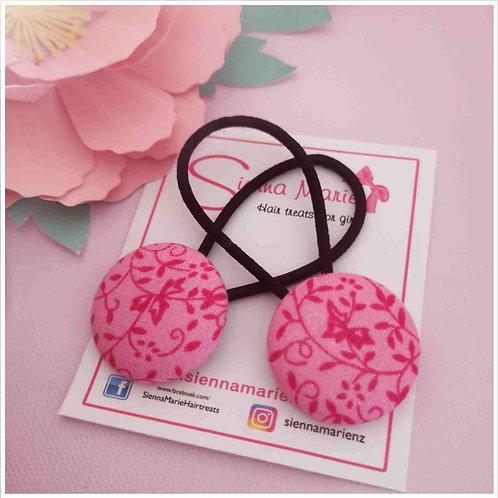 Pink print button hairtie pair