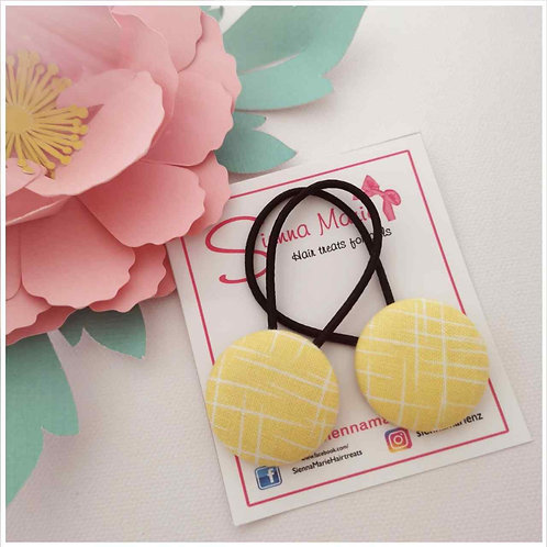 Yellow print button hairties