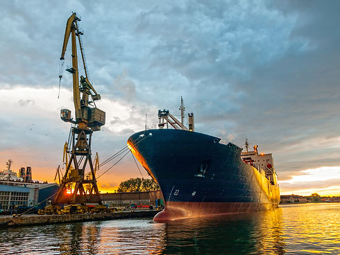 Cargo ship in the harbor at sunset. Gdan