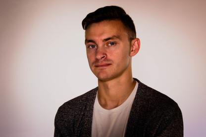 A portrait photo of a musician using spot lighting