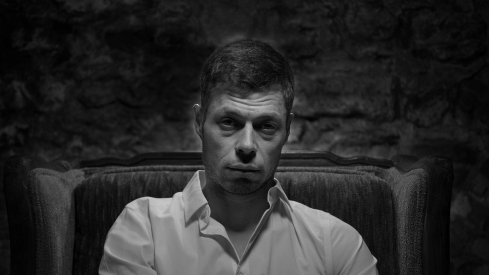 Moody black and white headshot of the musician Jared paul