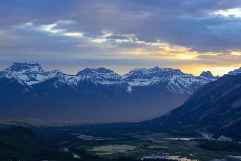 A mountain range in Banff Alberta Canada at sunset