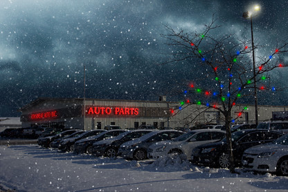 A composite photo of a used car dealership during Christmas time