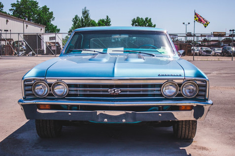 A classic Chevrolet Chevelle SS sits in a dealership lot