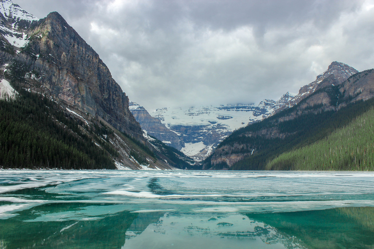 partially frozen lake louise in Banff Alberta Canada