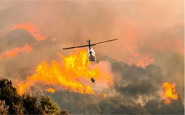 Fire helicopter fighting large fire