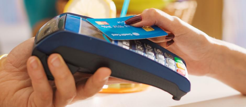 Paying with a contactless debit card.