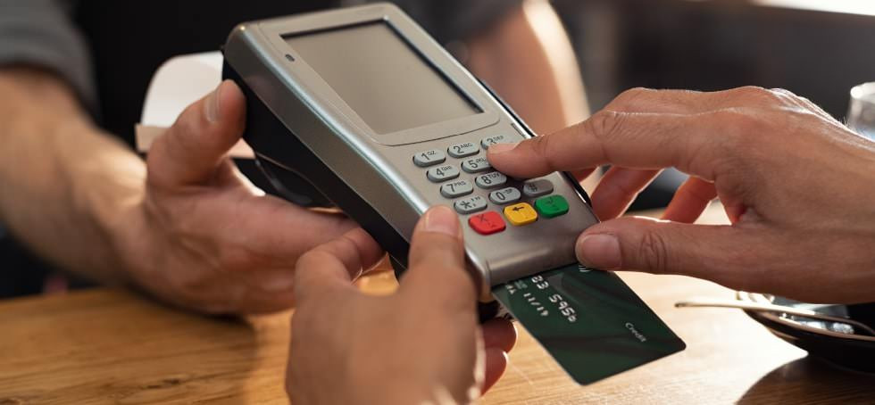 Paying for shopping using chip and pin.