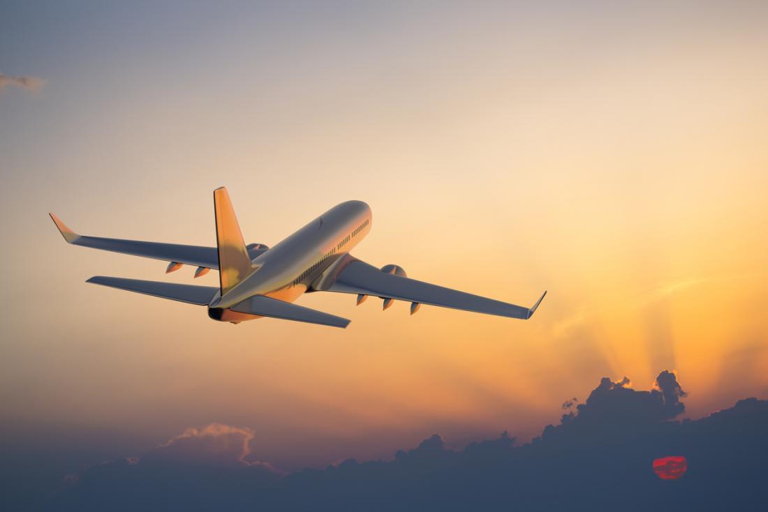 plane-flying-in-sunset