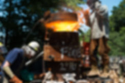 Foundry workers conduct an iron pour at the Metal Museum