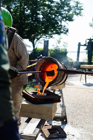 Molten iron is poured into a mold.