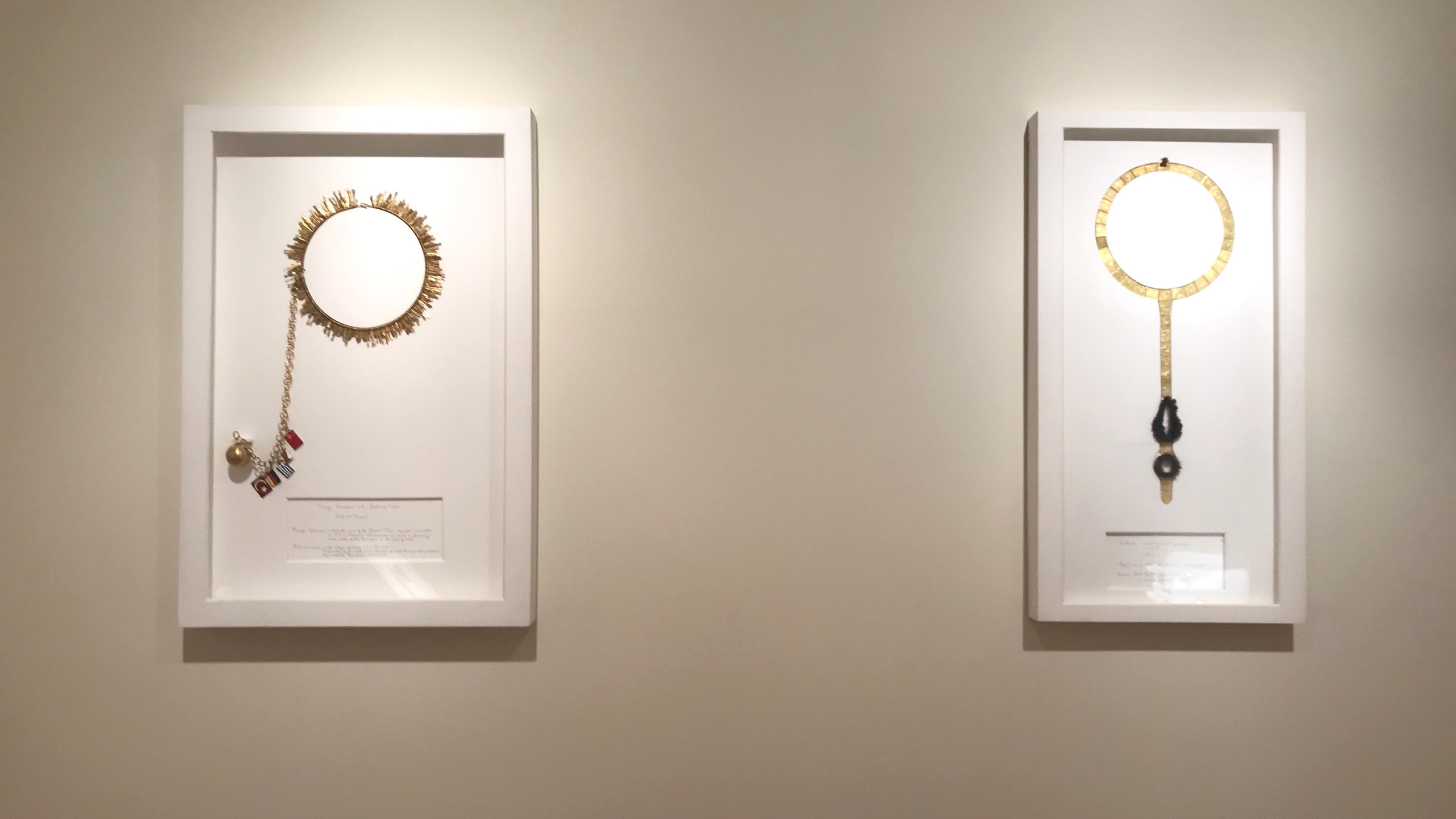 "(left): ""The Gold Standard Part III: Fringe Necklace with Ball and Chain."" Recycled gold, enamel, acrylic. Image courtesy of the Metal Museum.  (right): ""The Gold Standard Part III: Victorian Chastity Belt Necklace."" Recycled gold, hair. Image courtesy of the Metal Museum."
