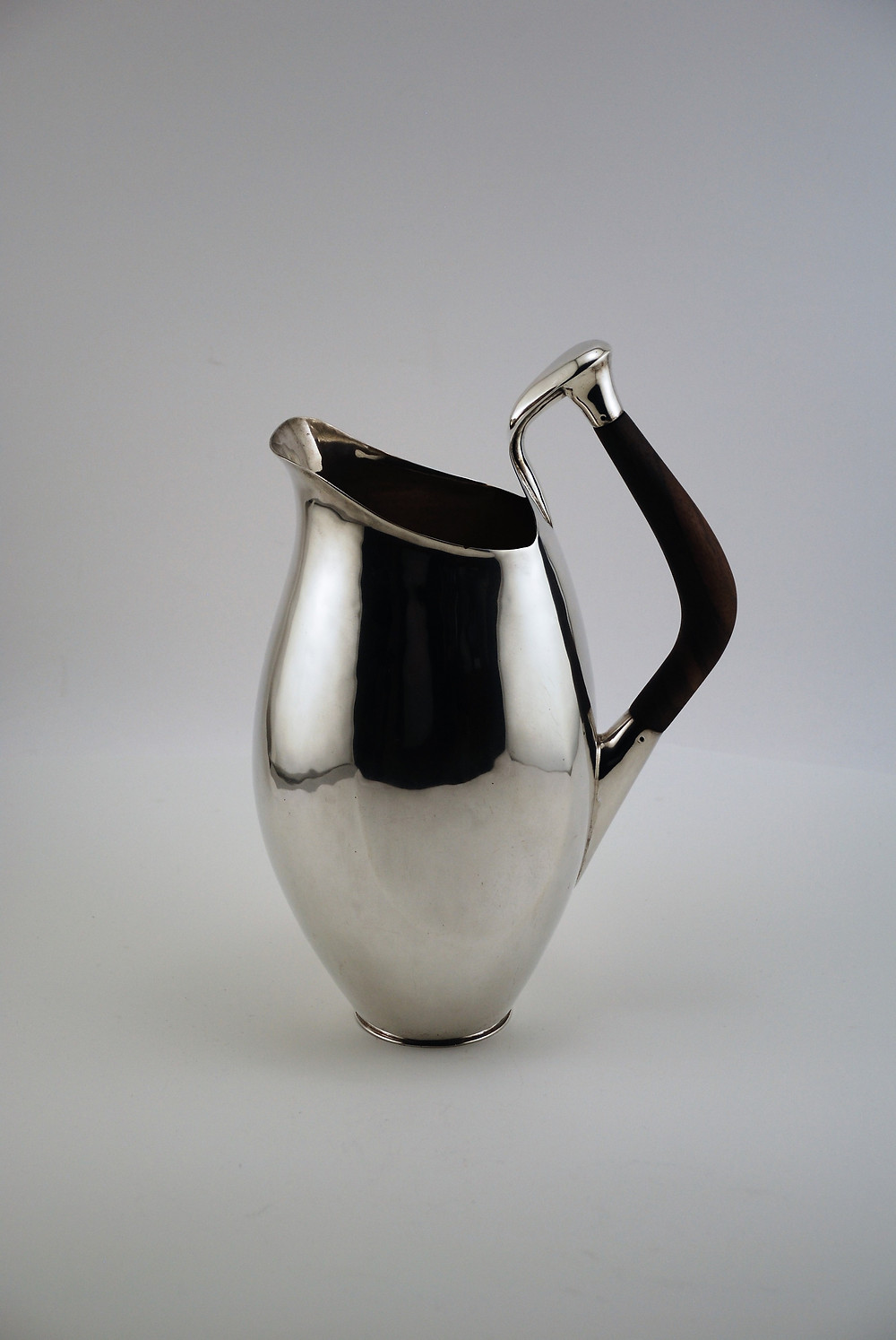 Mary Lee Hu, Pitcher, 1965. Sterling silver, wood. Gift of the Artist. This piece was created during her first year at Cranbrook Academy of Art.