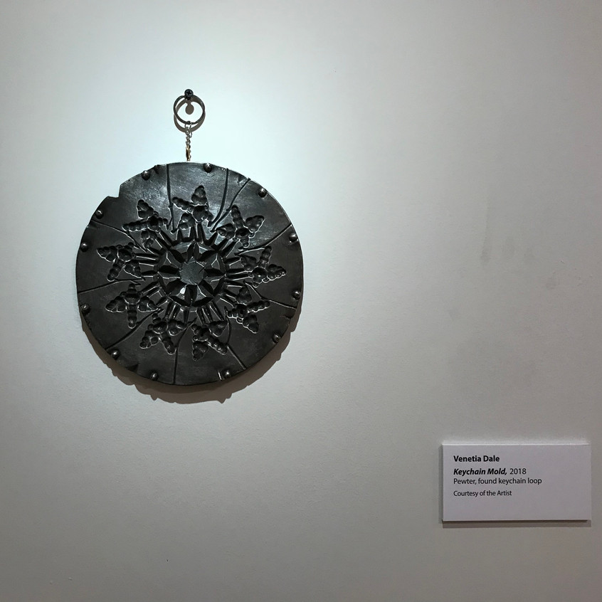"Venetia Dale. ""Keychain Mold."" 2018. Pewter, found keychain. Image courtesy of the Metal Museum."