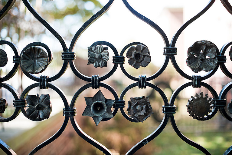 A close-up of small rosettes that adorn the Museum's entrance gates.