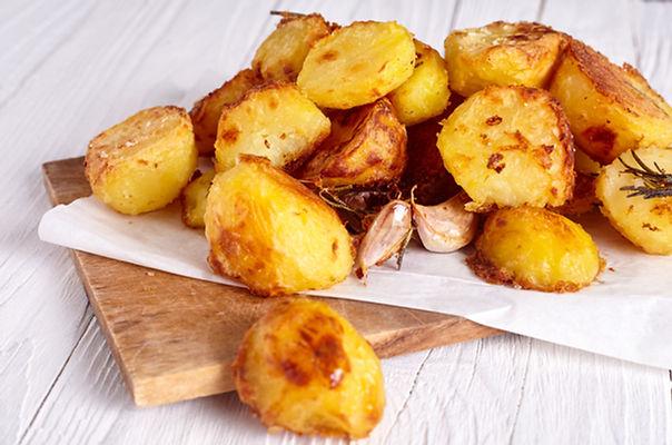 Roast potatoes seasoned with salt, garli