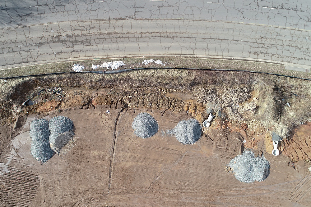 Aerial Image of stockpiles and site conditions.