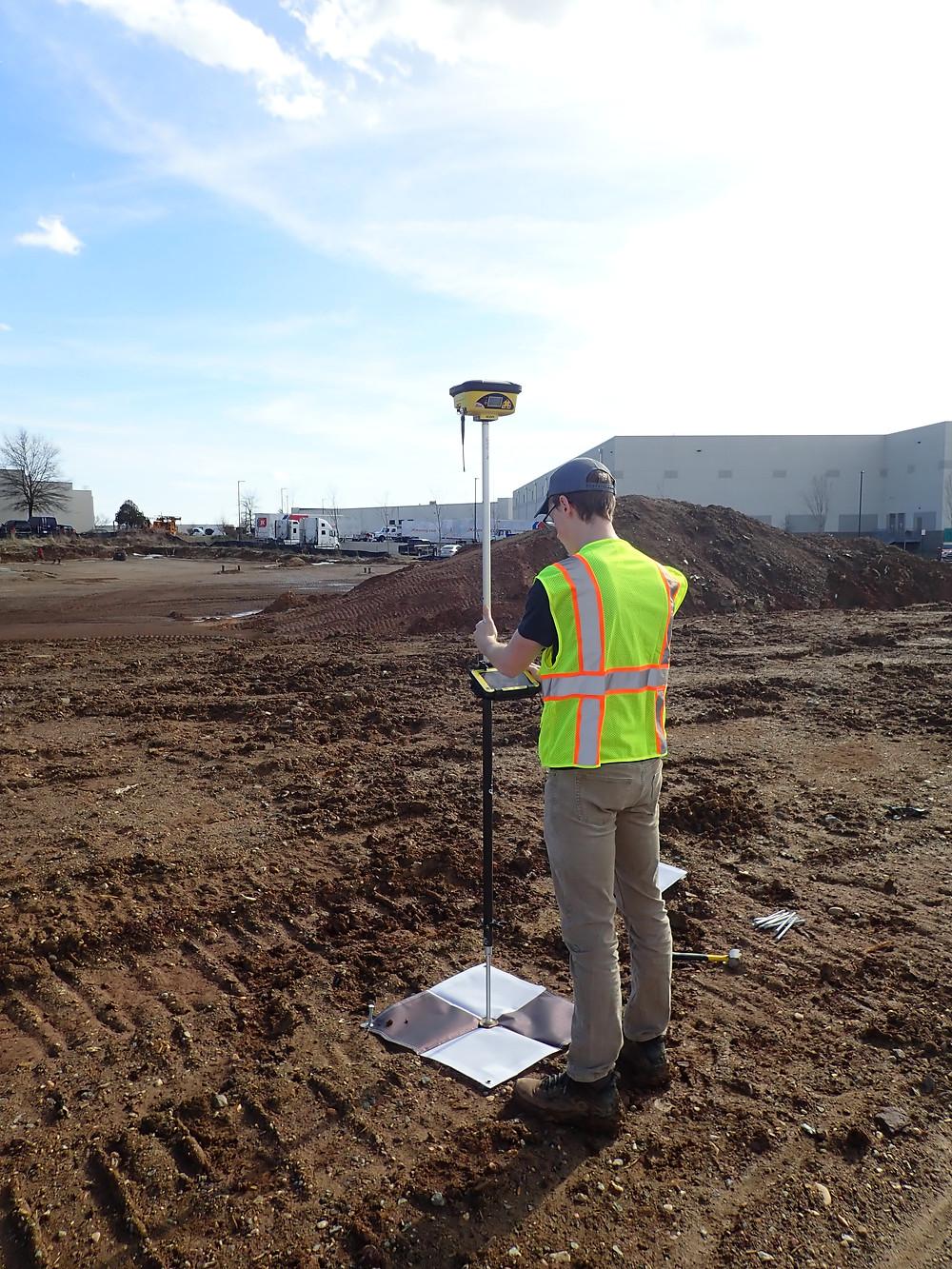UAS Team Member measuring GCP horizontal and vertical location.